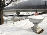 Wintry scene by the Susquehanna; monument is adjacent to stake.