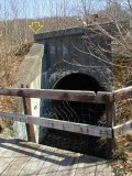 Side view of west parapet and concrete arch culvert.
