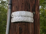Power pole identification numbers.