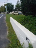 Looking west along the bridge and Route 26. The mark appears on the far end.