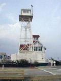 The old Coast Guard tower stands northeast of the mark.