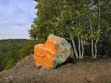 View of the orange-yellow boulder at south end of rock pile butte.