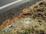 The boulder is just west of the edge of Route 402.
