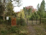 """Deer Exclosure,"" hiker access (left of gate)."