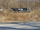 I caught a fleeting glimpse of this sleek, shiny Norfolk Southern locomotive across the street.
