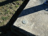 Eyelevel view of the disk set into the concrete base.