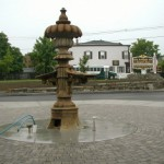 What remains of the fountain in June 2005. The fountain base and rim were removed.