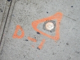 Eyelevel view of the disk on the sidewalk