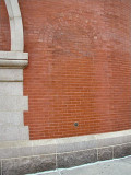 The mark is set in what appears to be a doorway or window that was bricked-over long ago.