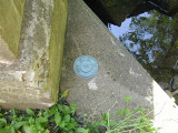 This disk can be found in the northwest wingwall of this bridge over Hettesheimer Run.