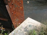 Eyelevel view of the disk on the bridge abutment.