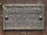 The plaque on the bridge indicates that it was erected by the American Bridge Company of New York in 1902.
