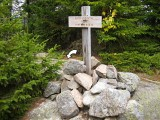 This summit sign is right along the trail, and the mark is just a few feet beyond it (mark indicated).