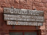 Mark (indicated) on the porch of the trading post (now Goulding's Museum).