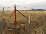 Corner of the fence and ROW post