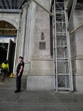 The mark is on the column just SW of the Fifth Avenue entrance.