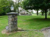 Post near entranceway, showing one address.