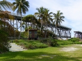 "Another view (to the SW) of the rail bridge, and a replica of Flagler's private railcar ""Rambler."""