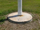 Eyelevel view of the disk on the flagpole base.