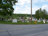 Looking NE toward the mark and sign, Drums Community Cemetery