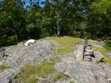 Mark (indicated) is close to the summit cairn.